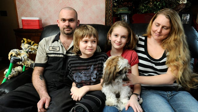 Austin Snyder, 12, of Mountain Home, (second from left) is shown here in 2012 with his family, Danny, sister Erika and mother Robyn.
