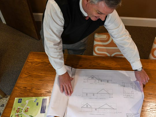 "Greg Skipper, director of the Calvary Home for Children in Anderson, looks at architect sketches while talking about adding two foster homes on the campus, on Tuesday. ""Calvary Home is the only home for children in the state (of South Carolina) that offers all three of group care, licensing of individual foster homes, and will have individual foster homes on campus,"" Skipper said. The foster care group is adding foster family community homes before the end of 2019."