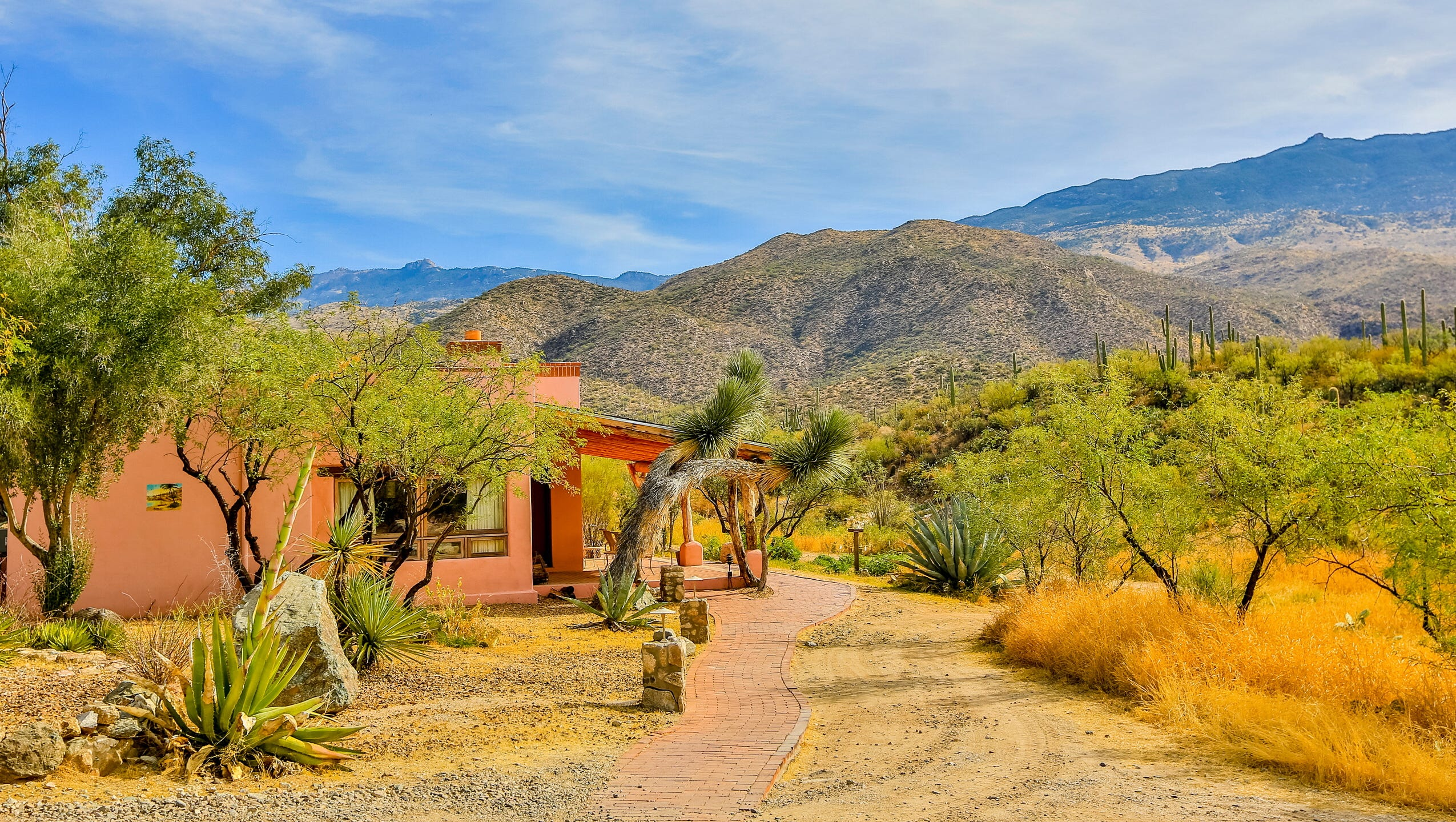 Tanque Verde Ranch guests stay in Santa Fe-style adobe buildings.