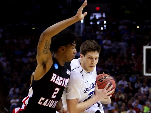 SAN ANTONIO, TX - MARCH 21:  Doug McDermott #3 of the Creighton Bluejays drives with the ball against Elfrid Payton #2 of the Louisiana Lafayette Ragin Cajuns in the first half during the second round of the 2014 NCAA Men's Basketball Tournament.