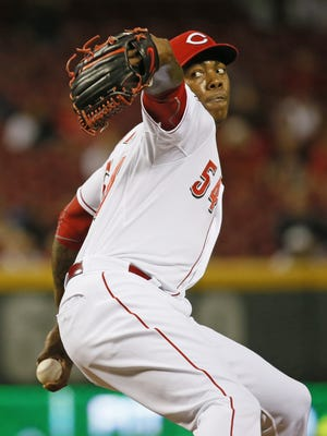 Reds relief pitcher Aroldis Chapman delivers a pitch on May 12 against the Braves.