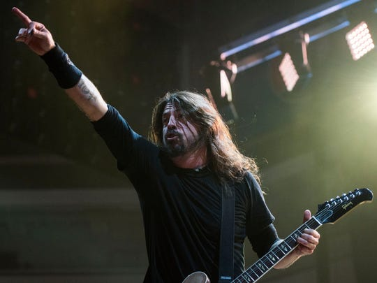Foo Fighters lead singer and guitarist Dave Grohl performs during the band's show at the Denny Sanford Premier Center on Saturday, Nov. 11, 2017.