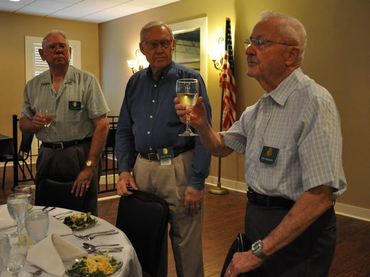 The Order of Daedalians 60th Flight members (from left) Jim Alexander, Chuck Tosten and Mac McBurney toast to the United States military, the Constitution and the Daedalians fraternity founders during the group's meeting last month.