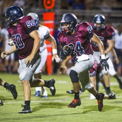 Perry High School's Samuel O'Hare, #50, and Kenny Fultz,