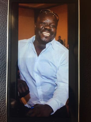 "This undated cellphone photo released by Dan Gilleon, the attorney for the family of Alfred Olango, shows Alfred Olango, the Ugandan refugee killed Tuesday, Sept. 27, 2016, in El Cajon, Calif. The fatal police shooting of Olango, who drew something from his pocket and extended his hands in a ""shooting stance"" happened about a minute after officers in a San Diego suburb arrived at the scene where a mentally unstable man was reportedly walking in traffic, a police spokesman said Wednesday."