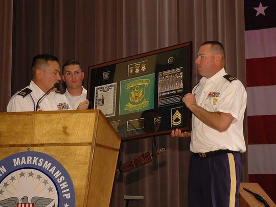 Members of the AMU presented a plaque to SFC James
