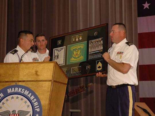 Members of the AMU presented a plaque to SFC James Henderson for his many years of contribution to the team.