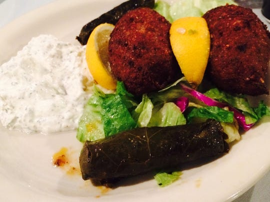 Kibby and meat-stuffed grape leaves at Athena's Greek and Lebanese Grill. The leaves are stuffed with beef, onion, pine nuts and spices.