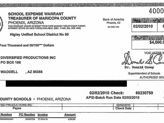 "Checks to Louis Hartwell's company from Higley Unified School District were to ""Diversified Productions Inc"" rather than LLC. Account information was redacted by The Arizona Republic."