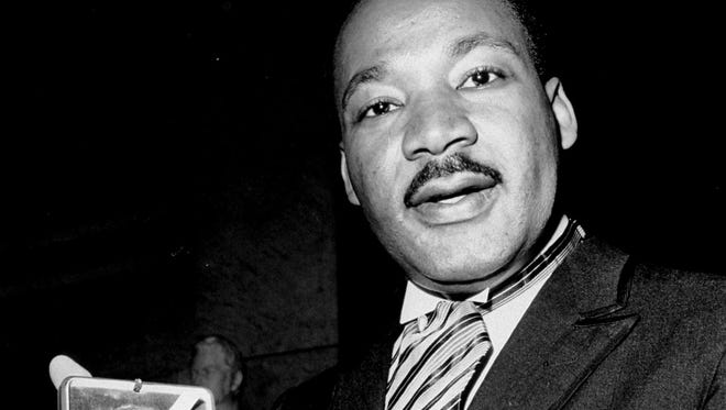 In this Dec. 10, 1964, file photo, U.S. civil rights leader Dr. Martin Luther King, Jr. holds his 1964 Nobel Peace Prize medal.