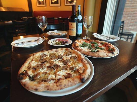 The Mama.Mia, smoked mozzarella, wood-roasted onions, fennel sausage (no tomato sauce) and the Margherita Pizza, San Marzano tomatoes, fresh mozzarella and basil at Pizzeria Posto in Rhinebeck, Jan. 20, 2017.