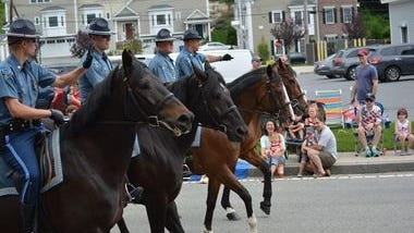 State Troopers and their magnificent horses drew many cheers from the crowd at the 2015 Burlington Fourth of July Parade WICKED LOCAL PHOTO/ CHRISTINE NICOLORO