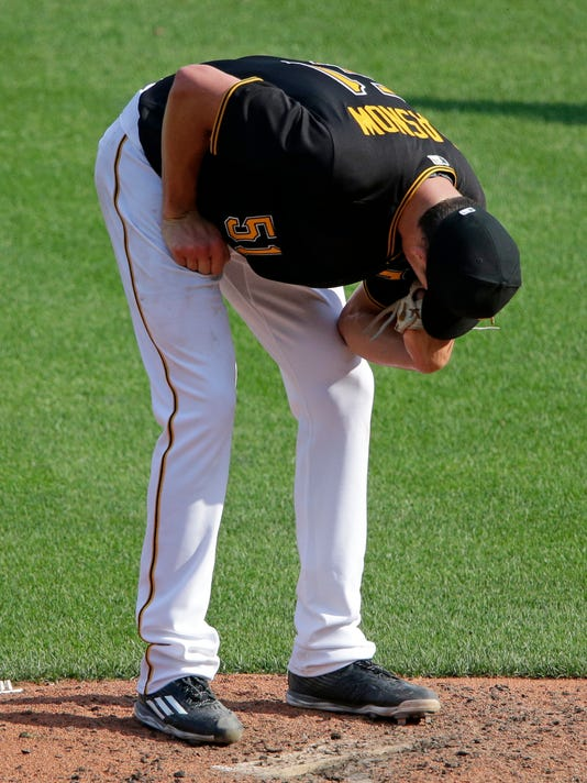 Pittsburgh Pirates starting pitcher Tyler Glasnow waits for a team trainer in the fourth inning of a baseball game against the Philadelphia Phillies in Pittsburgh, Saturday, July 23, 2016. Glasnow left the game with shoulder discomfort. (AP Photo/Gene J. Puskar)