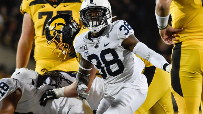 Penn State  safety Lamont Wade celebrates a sack against Iowa during the 2019 season. Wade, a fourth-year senior, was expected to compete for a starting position before the Big Ten postponed fall sports.