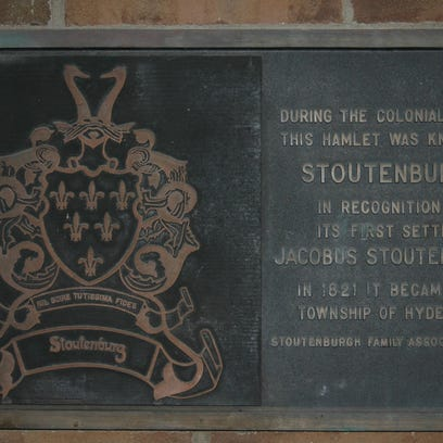 In 1976, this plaque was affixed to the exterior wall of Hyde Park's town hall to acknowledge the municipality's original name and to pay tribute to the town's first Colonial settler, Jacobus Stoutenburgh, who set down roots there in 1741.