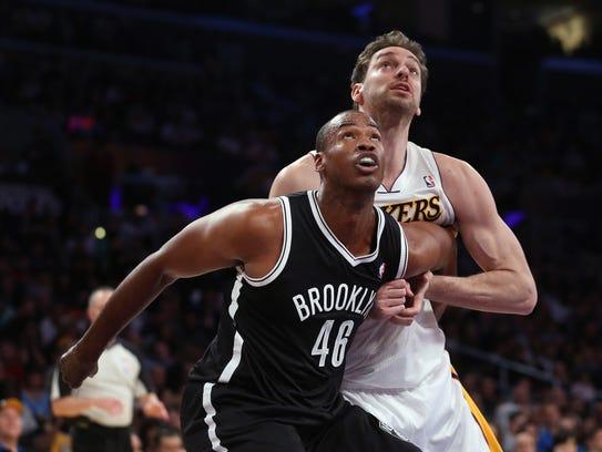 Jason Collins #46 of the Brooklyn Nets and Pau Gasol