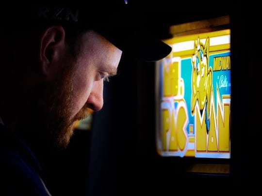 "Nathan Vanover, Boonville, tries his hand with a ""Ms Pac-Man"" game in the retro game arcade at the newly opened Secret Headquarters on North First Ave. in Evansville, March 18, 2016."