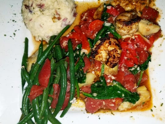 Crawdaddy's red snapper was seasoned with Cajun spice
