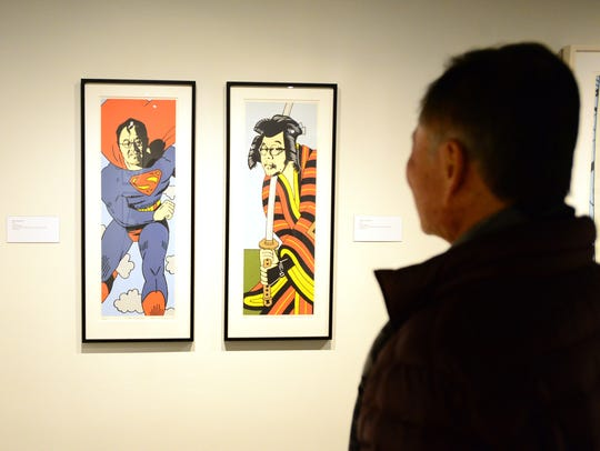 George Takei views the Roger Shimomura exhibit.
