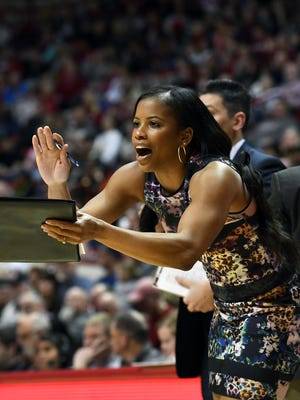 Indiana Hoosiers assistant coach Janese Banks cheers from the bench against Purdue at Simon Skjodt Assembly Hall in Bloomington, Ind., on Thursday, March 22, 2018.