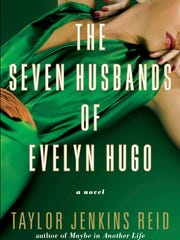"""This cover image released by Atria shows """"The Seven Husbands of Evelyn Hugo,"""" a novel by Taylor Jenkins Reid, available on June 13."""