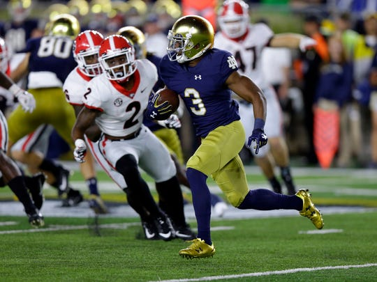 Notre Dame's C.J. Sanders (3) cuts in front of Georgia's Richard LeCounte III (2) on a kickoff return during the first half of an NCAA college football game in South Bend, Ind., Saturday, Sept. 9, 2017. (AP Photo/Michael Conroy)