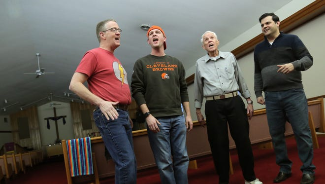 Jim Frye, Trevor Garrabrant, R.F. Miller and Dan Crow, members of the Fun Center Chordsmen's Bravada quartet, rehearse in the sanctuary of Southside Christian Church.