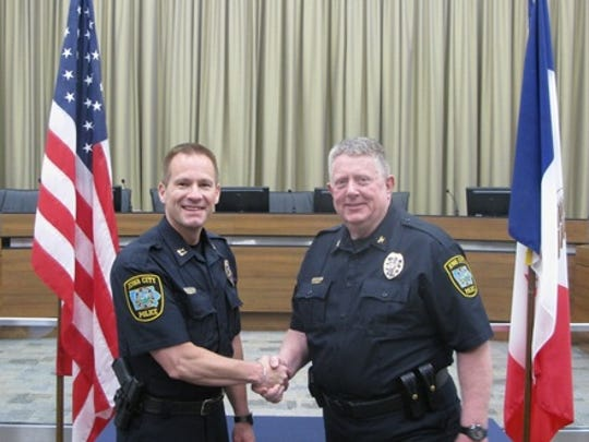 In 2016, Bill Campbell, left, was appointed Iowa City's Interim Police Chief. Pictured, Campbell shakes hands with former ICPD Chief Sam Hargadine, right, after being promoted to Police Captainon May 12, 2016.