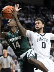 Michigan State guard Eron Harris drives the ball around Penn State forward Payton Banks during the second half Sunday. Harris finished with 13 points and five rebounds in 21 minutes.