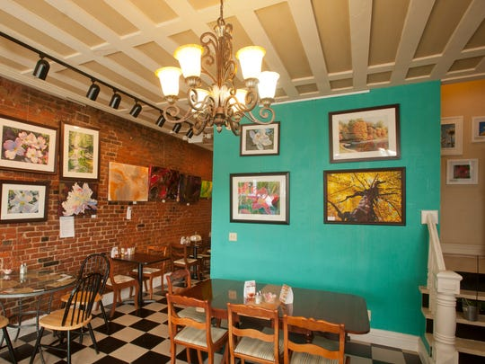 The interior of Cafe 157 on Main Street in New Albany. The home-cooking restaurant also serves as an art gallery.