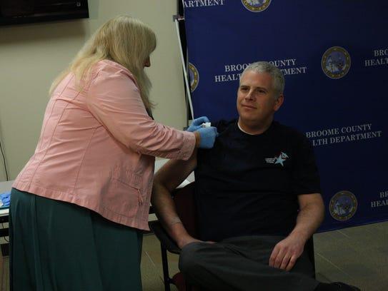 Broome County Executive Jason Garnar receives his flu