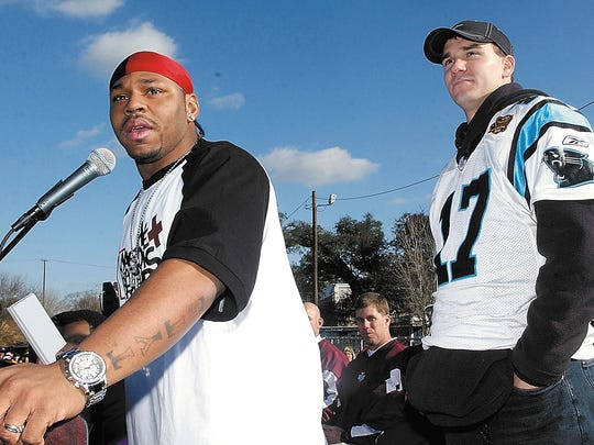 Kevin Faulk,left, running back for the Super Bowl Champion New England Patriots, left, from Carencro La., talks about Carolina Panthers quarterback, Jake Delhomme,right, Sunday Feb. 15, 2004 in Breaux Bridge La. Faulk came to Breaux Bridge to congratulate Delhomme on a great season and Super Bowl after the 2004 Parade of Stars made it way theough Breaux Bridge which honored Delhomme and Domanick Davis fron the Houston Texans, along with three members of the LSU Tigers 2003 BCS National Champion football team. Photo by Brad Kemp/PHOTO IN BRADS FOLDER--COLOR