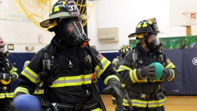 Webster firefighters Joe Battaglia and Mike Ricci contemplate their next move.