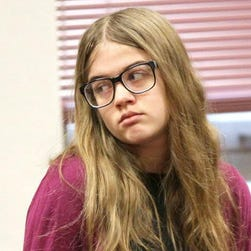 Morgan Geyser of Waukesha, Wis., accused along with her friend, Anissa Weier, of stabbing their sixth-grade classmate on May 31, 2014, in hopes of appeasing a fictional Internet character called Slender Man, is led Sept. 21, 2015, into a Waukesha County Circuit courtroom for a hearing. Here she looks toward where her parents are seated in the gallery.