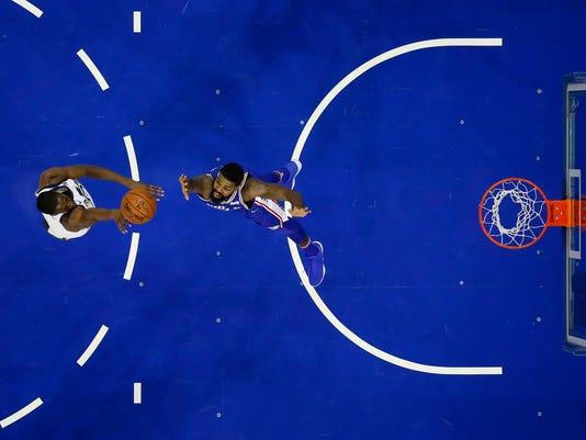 Utah Jazz's Ekpe Udoh, left, goes up for a shot as Philadelphia 76ers' Amir Johnson defends during the first half of an NBA basketball game, Monday, Nov. 20, 2017, in Philadelphia. (AP Photo/Matt Slocum)