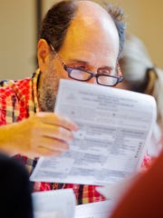 Volunteer Michael Krasnow helps hand-count ballots during the recount of the Democratic gubernatorial primary at Chittenden Superior Court in Burlington in September 2010. Ballots were re-counted in all of Vermont's 14 counties.