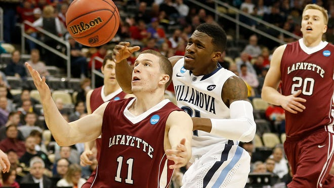 Lafayette Leopards guard Nick Lindner (11) battles for the ball with Villanova Wildcats guard Dylan Ennis (31) during the second half in the second round of the 2015 NCAA Men's Tournament at Consol Energy Center.