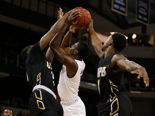 Arkansas-Pine Bluff forward Trent Steen, left, blocks a shot by Cincinnati guard Keith Williams, center, as Arkansas-Pine Bluff 's Charles Jackson defends during the first half of an NCAA college basketball game, Tuesday, Dec. 19, 2017, in Highland Heights, Ky. (AP Photo/Gary Landers)