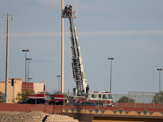 The Las Cruces Fire Department provides an aerial view for the Las Cruces Police Department photo and evidence technician investigating a fatal officer-involved shooting on the Lohman Avenue bridge over Interstate 25 on Sunday, Aug. 21, 2016.