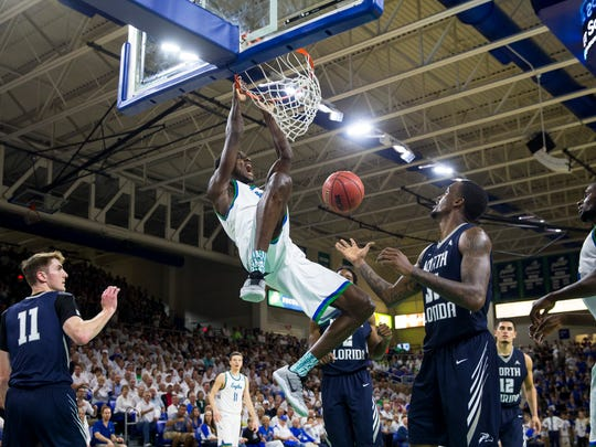 Florida Gulf Coast University senior, Demetris Morant, #21, yells after he slam dunked the ball during the ASUN Championship Final against the University of North Florida at Alico Arena in Estero, Florida on Sunday, March 5, 2017. The Eagles defeated the Ospreys 77-61.