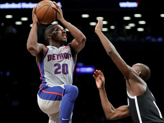 Dwight Buycks #20 of the Detroit Pistons takes a shot against Milton Doyle #14 of the Brooklyn Nets in the fourth quarter during their game at Barclays Center on January 10, 2018 in the Brooklyn borough of New York City.