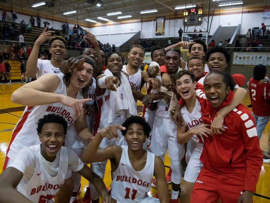 The Bosse Bulldogs pose for a team portrait after beating Harrison 106-63 for the SIAC championship at Central High School Saturday night.