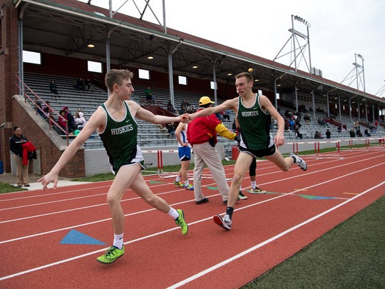 North's Zach Laurence transfers the baton to Greer Opel in the 3200 meter relay at Bosse's track meet at Enlow Field Tuesday evening. Bosse hosted the first track meet at the facility in more than 10 years after having their track resurfaced.