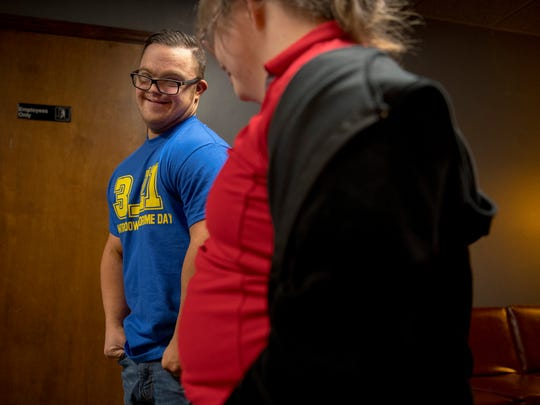 Collin Clarke, left, visits with Tess Fuller at an ice cream social at SMILE on Down Syndrome in Evansville in March of 2018. The two dated when they were younger, but are just good friends now.