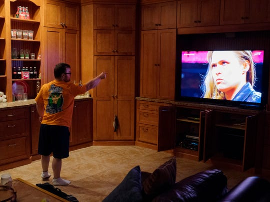 Collin Clarke couldn't remain seated once World Wrestling Entertainment newcomer Ronda Rousey appeared on the big screen television in Jeff Kosor's man cave in February of 2018. To say Collin is a big fan of the WWE would be an understatement. The WWE is what triggered his quest to become a bodybuilder.