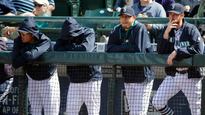 Seattle Mariners lean on the dugout rail in the ninth inning of a baseball game against the New York Yankees, Wednesday, June 3, 2015, in Seattle. The Yankees won 3-1. (AP Photo/Ted S. Warren)