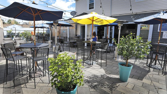The outdoor dining area of the Pour Yard on Washington Street is a spot for socially distant dining in Quincy.