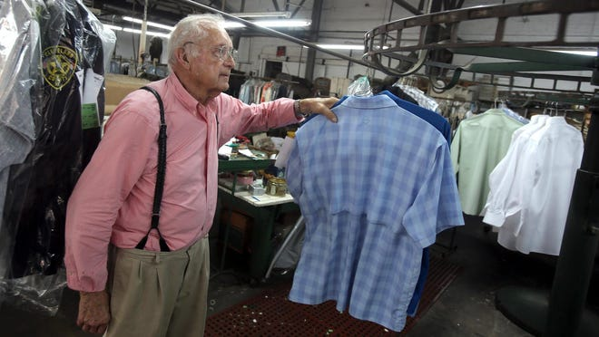 Lyman Jones checks on clothing at Nu-Way Laundry and Cleaners in uptown Shelby on Friday.