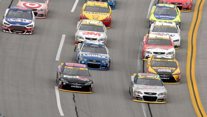 Dale Earnhardt Jr., bottom right, likely lost a spot in the Chase for the Sprint Cup championship race because of a controversial finish at Talladega Superspeedway last October.