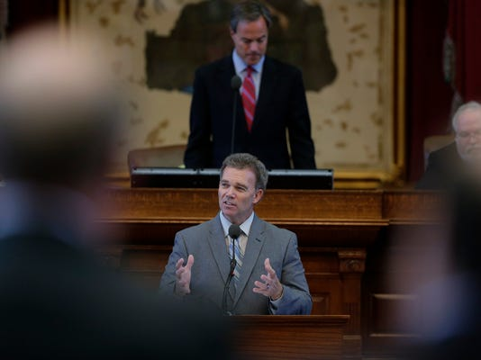 Rep. Joe Pickett, D-El Paso, center, stands below Texas Speaker of the House Joe Straus, R-San Antonio, as he answers question about a transportation bill, Monday, July 29, 2013, in Austin, Texas.